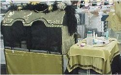 gold curtain set up with table
